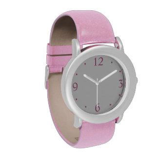 Llano con el reloj rosado   de los niños del brill