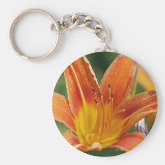 Llavero anaranjado de la flor