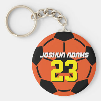 Llavero anaranjado del balón de fútbol del equipo