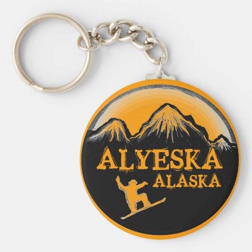 Llavero anaranjado del snowboarder de Alyeska Alas