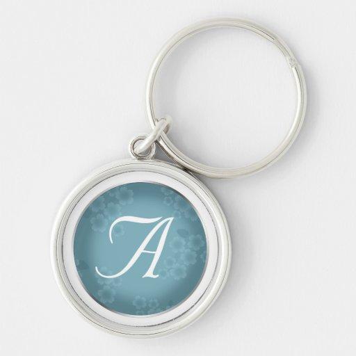 Llavero azul del monograma de la pizarra floral de