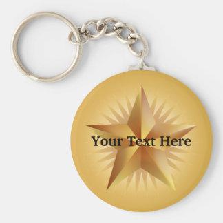 Llavero brillante de la estrella del oro