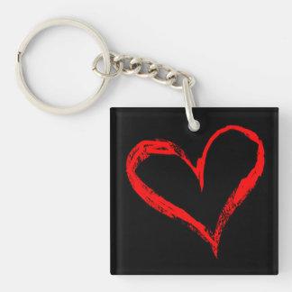 Llavero de doble cara del corazón rojo y negro