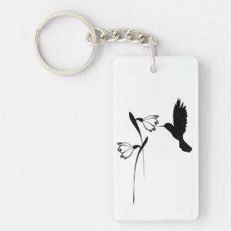 Llavero de la silueta del colibrí y de la flor