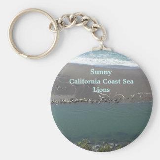 Llavero de los leones marinos soleados de la costa