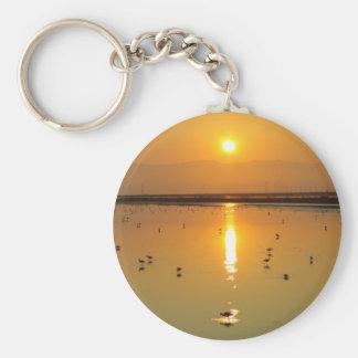 Llavero de oro de la salida del sol