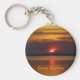 Llavero de piedra de la puesta del sol del puerto