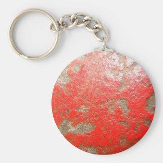 Llavero de piedra pintado rojo macro