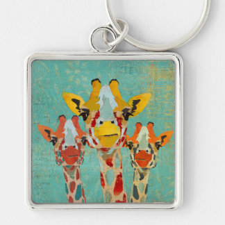 Llavero de tres jirafas que mira a escondidas