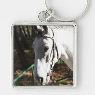 Llavero del caballo blanco