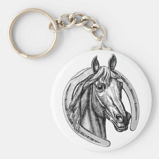 Llavero del caballo y de la herradura del vintage