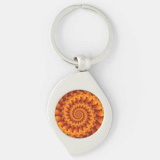 Llavero espiral anaranjado del fractal llavero plateado en forma de espiral