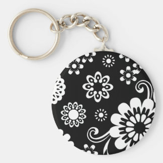 Llavero floral blanco y negro de la MOD…