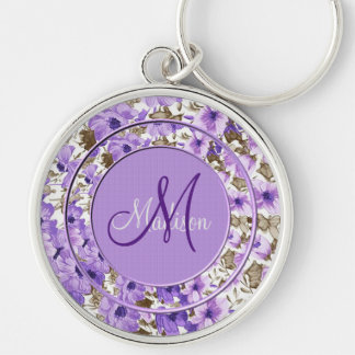Llavero floral púrpura y blanco del monograma