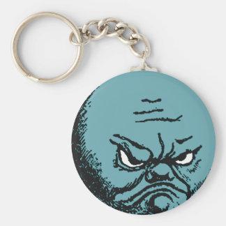 Llavero gruñón enojado de la cara de luna azul