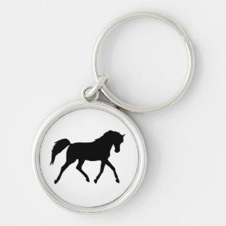 Llavero negro de la silueta el trotar del caballo,