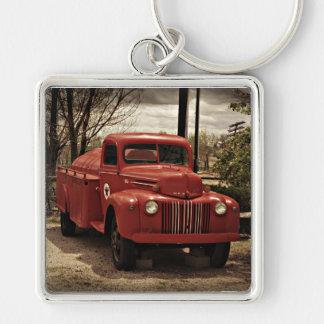 Llavero rojo viejo del coche de bomberos