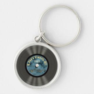 Llavero superior (azul) del disco de vinilo del