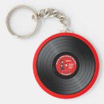 Llavero viejo del disco de vinilo del tipo del eje