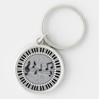 Llaves circulares del piano con el centro de las llavero redondo plateado