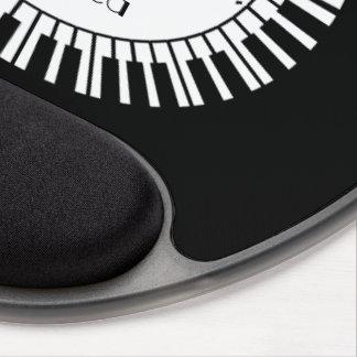 Llaves circulares del piano y notas embarulladas alfombrilla gel