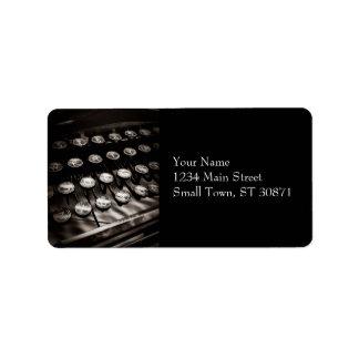 Llaves de la máquina de escribir del vintage en etiquetas de dirección