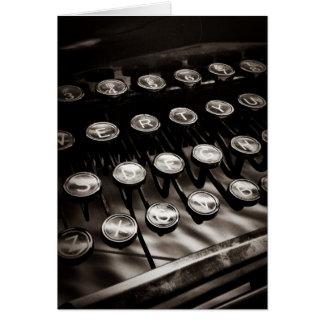Llaves de la máquina de escribir del vintage en tarjeta pequeña
