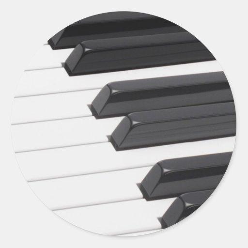 Llaves de teclado del piano o del órgano etiquetas redondas