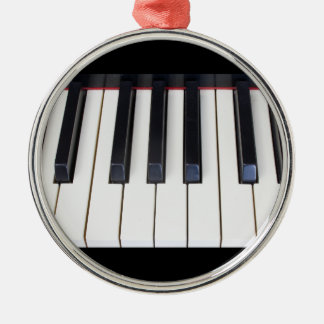 Llaves del piano adorno navideño redondo de metal