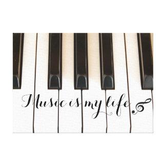 Llaves del piano con cita de la música impresión de lienzo