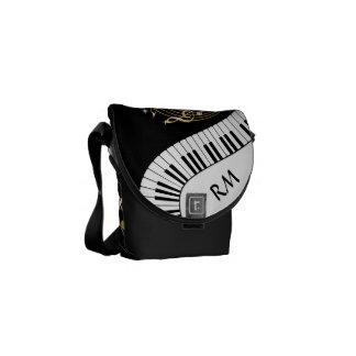 Llaves del piano del monograma y notas musicales bolsas messenger