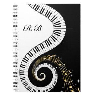Llaves del piano del monograma y notas musicales libro de apuntes