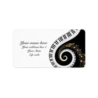 Llaves del piano del monograma y notas musicales etiquetas de dirección
