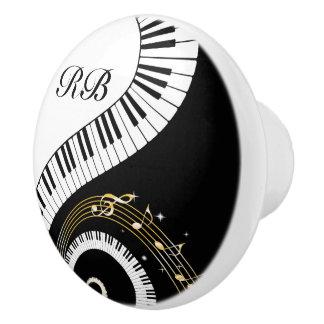 Llaves del piano del monograma y notas musicales pomo de cerámica
