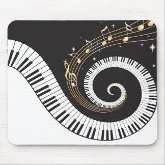Llaves del piano que remolinan tapetes de ratón