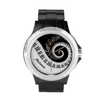 Llaves del piano y notas adaptables de la música reloj