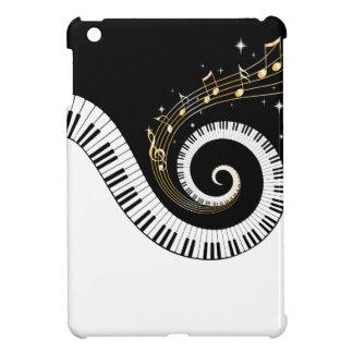 Llaves del piano y notas de la música del oro