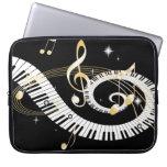 Llaves del piano y notas de oro de la música fundas computadoras