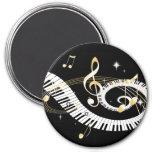 Llaves del piano y notas de oro de la música imán de frigorifico