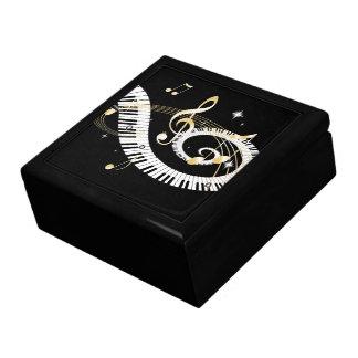 Llaves del piano y notas de oro de la música caja de recuerdo