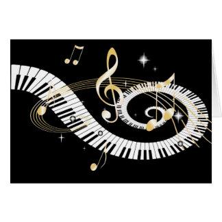 Llaves del piano y notas de oro de la música tarjeta de felicitación