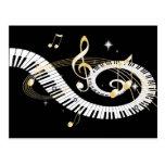 Llaves del piano y notas de oro de la música postales