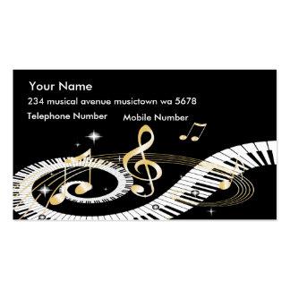 Llaves del piano y notas de oro de la música tarjetas de visita