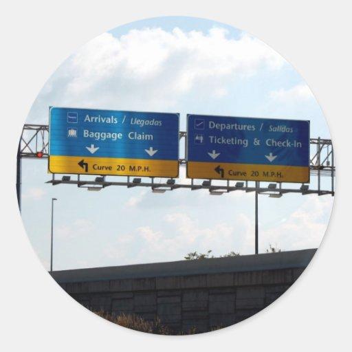 Llegadas y salidas del aeropuerto del IND Etiqueta Redonda