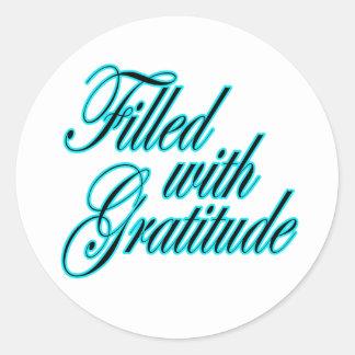 Llenado del pegatina de la gratitud