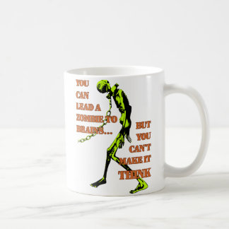 Lleve una taza verde del zombi