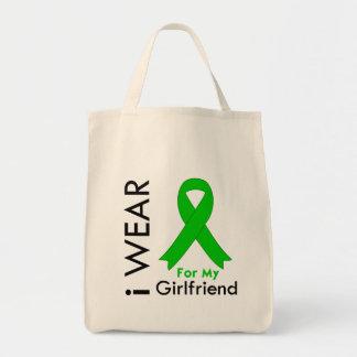 Llevo una cinta verde para mi novia bolsa de mano