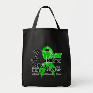 Llevo una cinta verde para mis pacientes bolsa tela para la compra