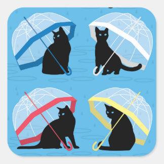 Lloviendo gatos de n de los gatos los 'ajustan al pegatina cuadrada