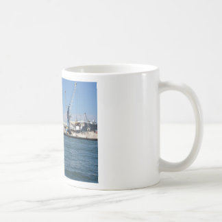 Loading cargo of raw materials from a port mooring classic white coffee mug